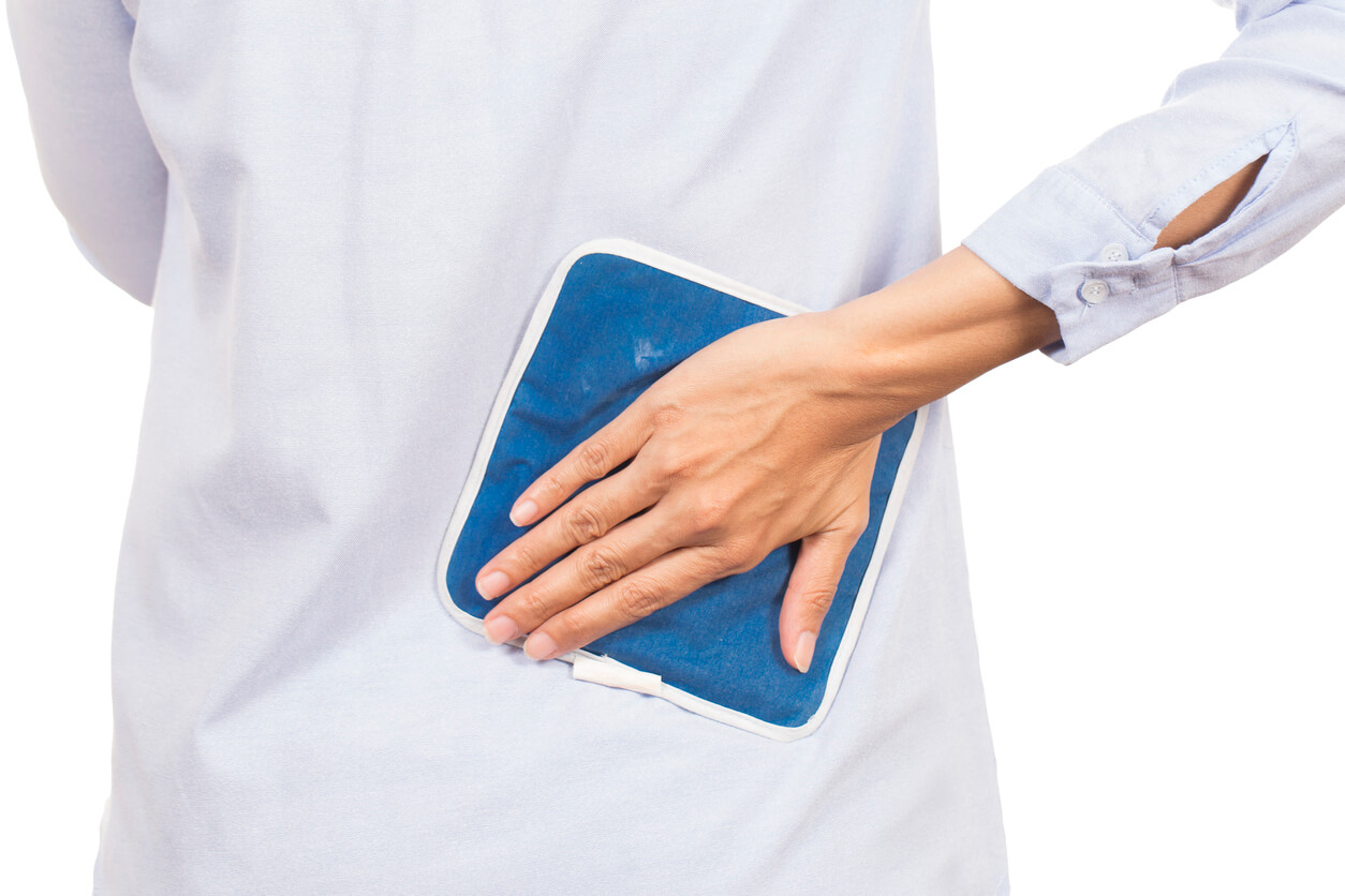 woman-holding-ice-pack-on-lower-back-arthritis